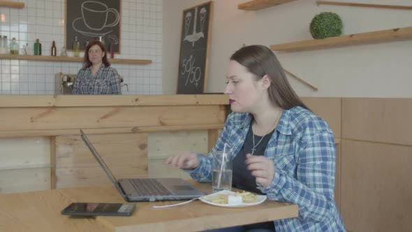 Thumbnail for Busy Female It Programmer Working on Laptop in Cafe