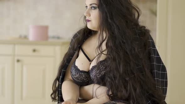 Thumbnail for Attractive Plump Girl with Long Hair and Black Bra Posing at the Camera. Sensual Young Over Size