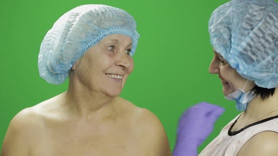 Thumbnail for Smiling Elderly Female in Protective Hat. Plastic Surgeon Checking Woman Face