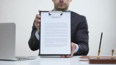 Business Lawyer Holding Contract