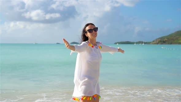 Thumbnail for Young Beautiful Woman Having Fun on Tropical Seashore. Happy Girl Walking at White Sand Tropical