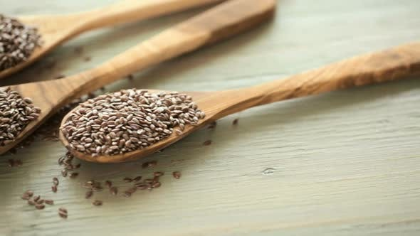 Flax seeds on painted wood board