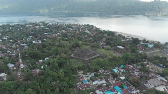 Thumbnail for Aerial: flying over Bandaneira village Fort Belgica Indonesia Banda Islands