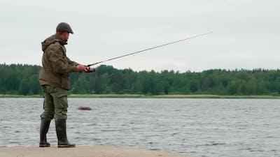Fisherman On A Lake Pier