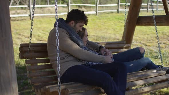Thumbnail for Young couple on a swing