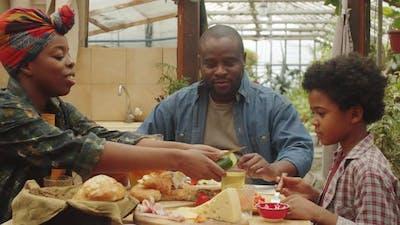 Afro Family Enjoying Meal at Farm