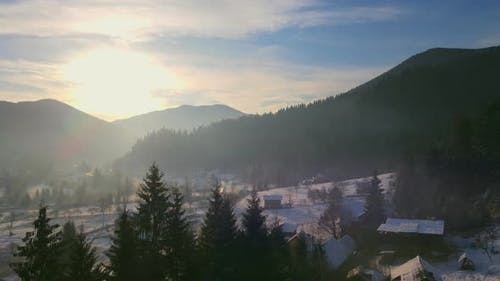 Winter Landscape of Sunrise Over the Mountains in Winter