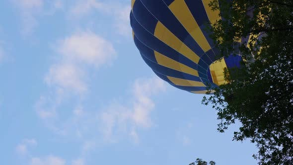 Thumbnail for Bottom View of Beautiful Hot Air Balloon Flying Over the Trees, Leisure Activity