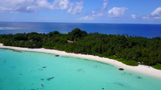 Beautiful overhead tourism shot of a sunshine white sandy paradise beach and aqua turquoise water ba