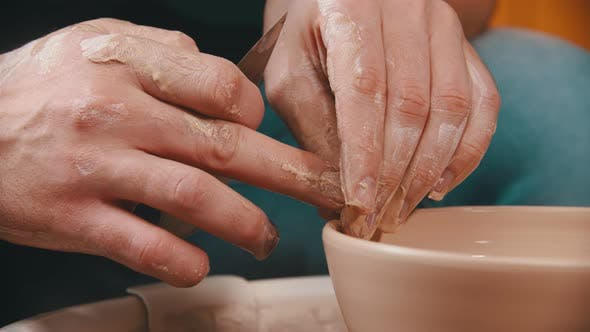 Thumbnail for Pottery - the Master with the Help of His Fingers Is Making the Edges of the Clay Bowl Smooth