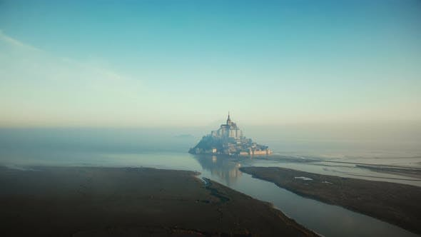 Thumbnail for Atmospheric Cinematic Aerial Shot of Foggy Sunrise Mont Saint Michel on High Tide, Famous Island