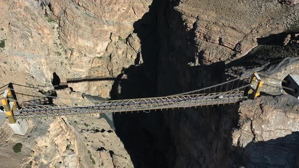 Thumbnail for Aerial Shot of a Car Driving on Asia's Highest Bridge , Chicham Khaas , Spiti Valley , Pull Up Shot