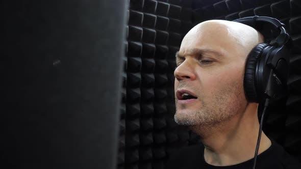 Thumbnail for Bald Singer Records Song at Recording Studio
