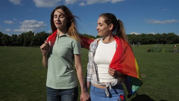 Thumbnail for Happy Girlfriends with Lgbt Flag Walking on Lawn
