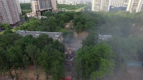 Thumbnail for Aerial Shot of Old Building Demolition in New Residential Area