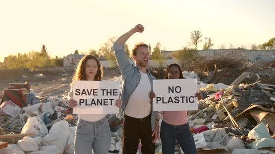 Ecology Activists Holding Signs Agains Pollution at Trash Pill