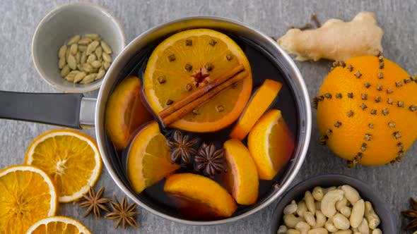 Thumbnail for Pot with Hot Mulled Wine, Orange Slices and Spices 28