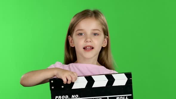 Thumbnail for Baby Holds in Hands Clapperboard. Green Screen