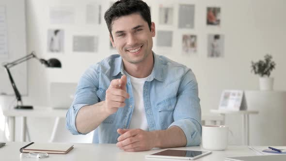 Thumbnail for Casual Young Man Pointing with Finger toward Camera