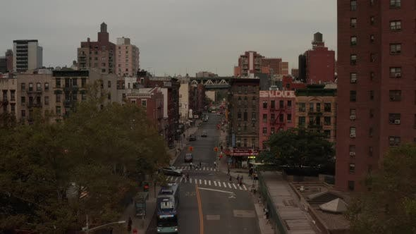 Thumbnail for Low Flight Through Manhattan, New York City Street with Bus Stopping in Chinatown,
