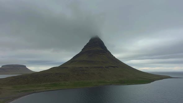 Kirkjufell Mountain in Summer and Cloudy Sky. Iceland. Aerial View
