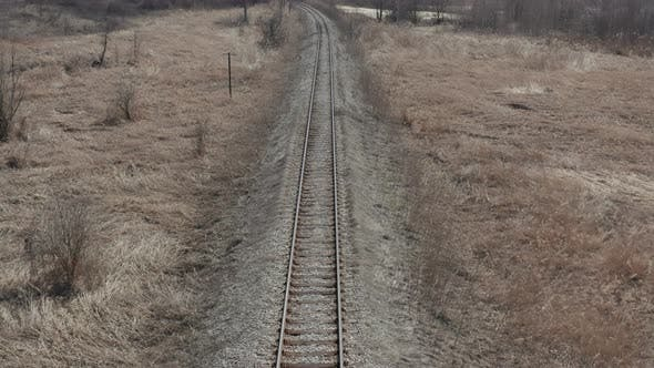 Tranquil scene of swaying grass and railroad track 4K drone video
