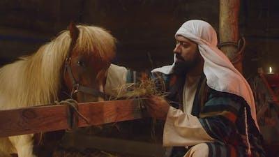 Joseph Giving Hay to Horse