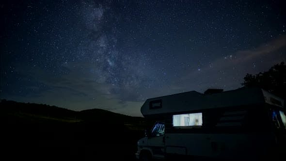 Thumbnail for Night sky with milky way above motorhome.