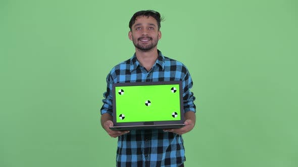 Thumbnail for Happy Young Bearded Persian Hipster Man Thinking While Showing Laptop