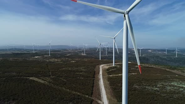 Thumbnail for Aerial View of Windmills on Wind Farm in Rotation