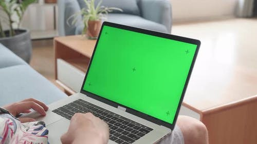 Close Up Man Using Laptop Computer With Green Screen At Living Room