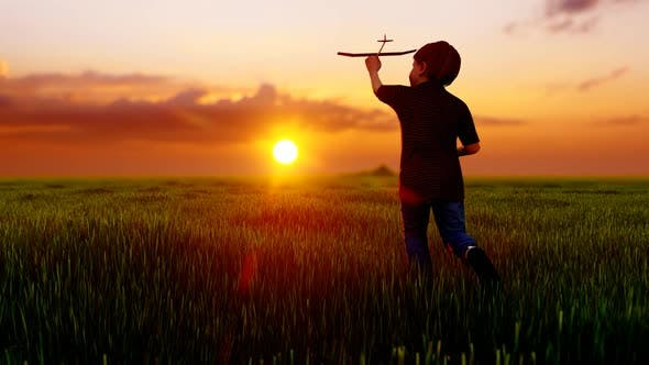 Thumbnail for Boy Playing In An Empty Green Field Against The Sunset