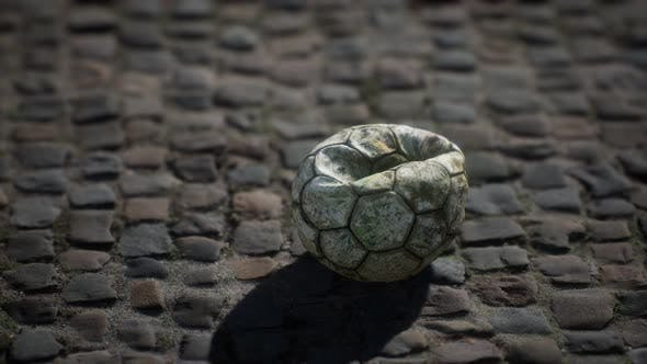Thumbnail for Old Soccer Ball in the Pavement Yard