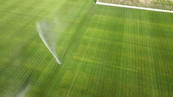 Cover Image for Aerial View on Top Automatic Watering of the Stadium and Green Grass. Irrigation of Green Grass
