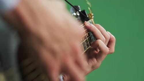 Playing on the fretboard of a guitar