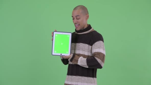Thumbnail for Happy Bald Multi Ethnic Man Talking While Showing Digital Tablet