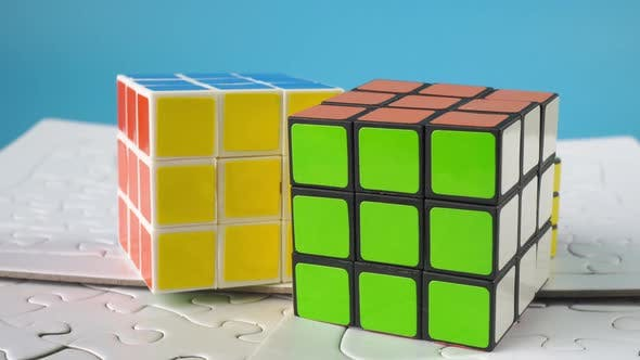 Rubik cube and jigsaw puzzle.