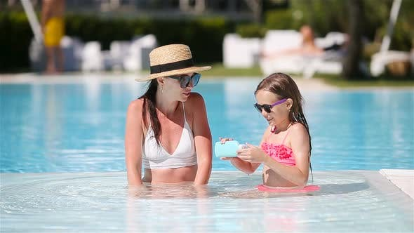 Thumbnail for Family Enjoying Summer Vacation in Luxury Swimming Pool