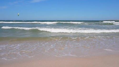 Paradise Beach with Beautiful Sea Waves on a Sandy Beach on a Sunny Day