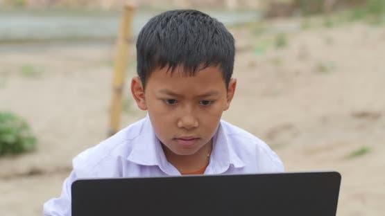 Asian Boy Using Computer