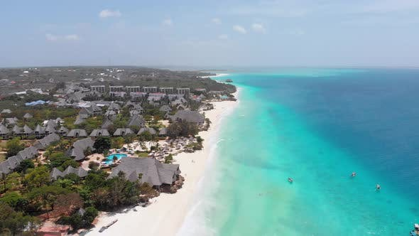 Aerial Paradise Sandy Beach with Turquoise Ocean and Luxury Hotels in Zanzibar