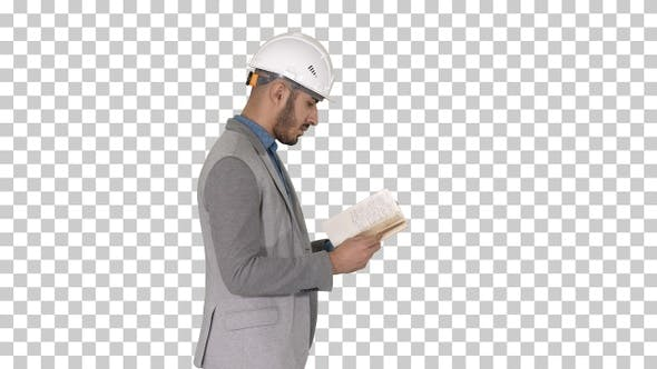 Thumbnail for Young architect reading textbook or notebook while walking