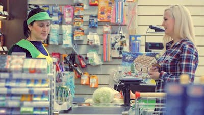 Woman at the Cash Desk at Grocery Store
