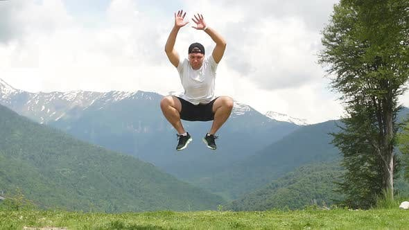 Thumbnail for Happy Man Jumping at Mountains To Clouds Sky. Lifestyle Travel Emotional Euphoria Success Concept