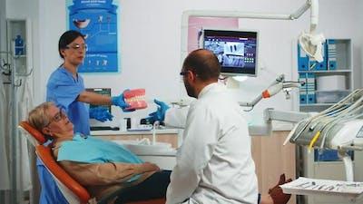 Stomatologist Explaining Dental Hygiene Using Dental Skeleton