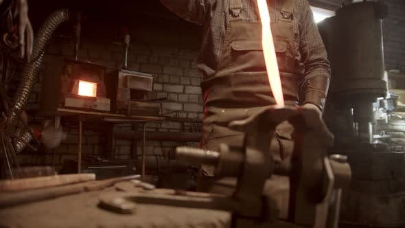 Thumbnail for A Man Blacksmith Forging a Knife - Putting the Sample Between the Clamps