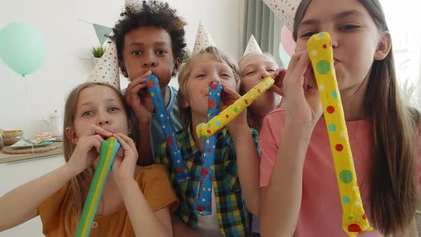 Kids Blowing Party Horns