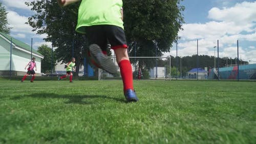 Group of Young Boys Play Soccer, Training Day on the Football Field, Teenagers Play Football