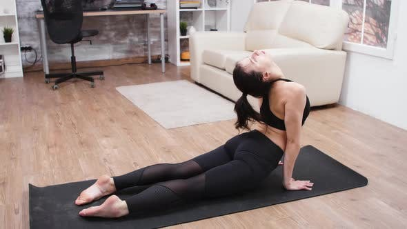 Thumbnail for Attractive Woman in Leggings Stretching Her Back