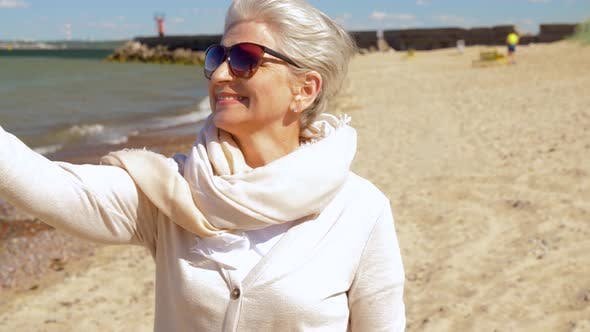 Thumbnail for Senior Woman Taking Selfie By Smartphone on Beach